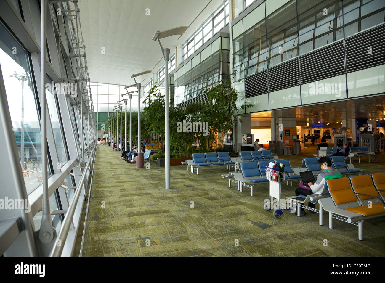 A seating area in Changi airport, Singapore - Stock Image