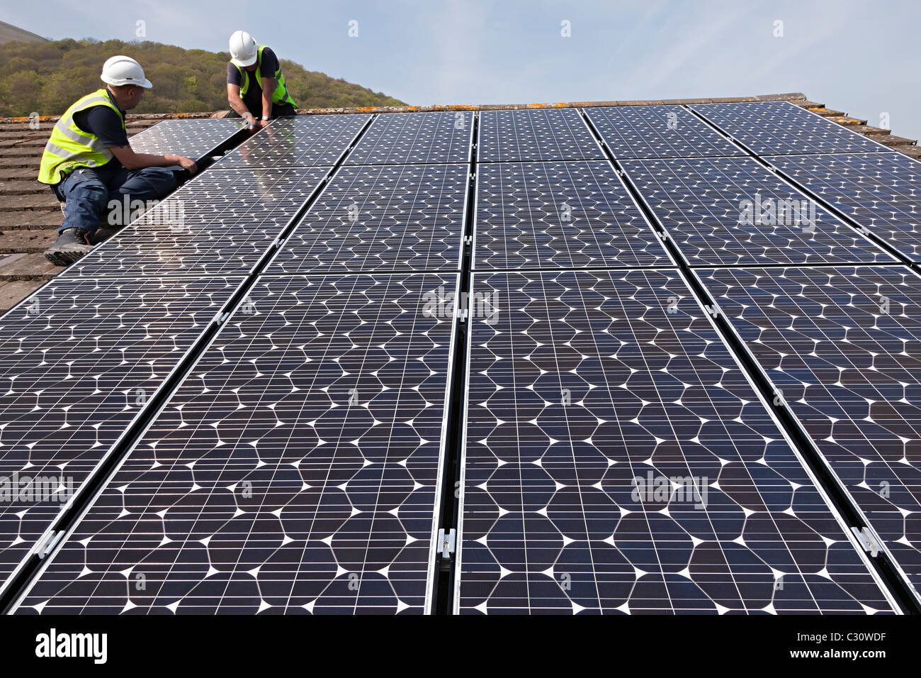 Fitting Solar Pv Panels To A House Roof Wales Uk Stock