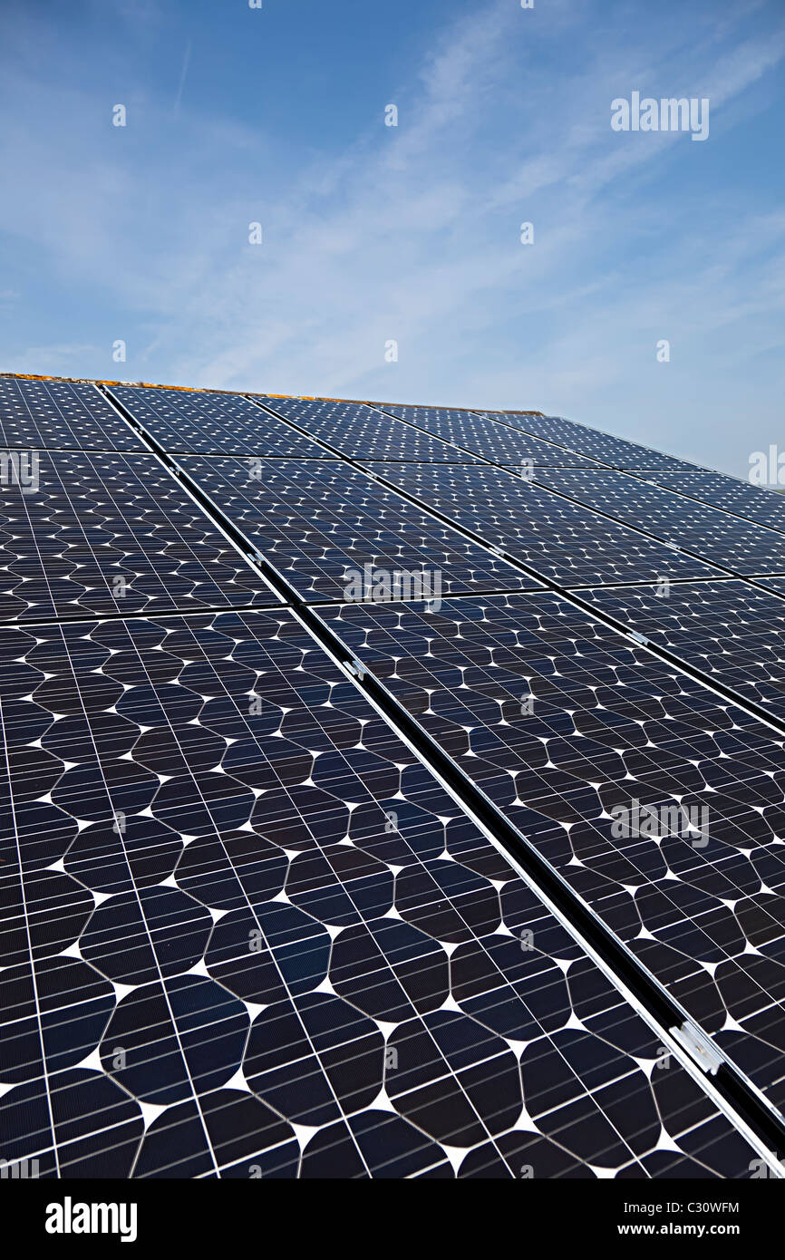Sanyo solar pv photovoltaic panels on house roof Wales UK - Stock Image