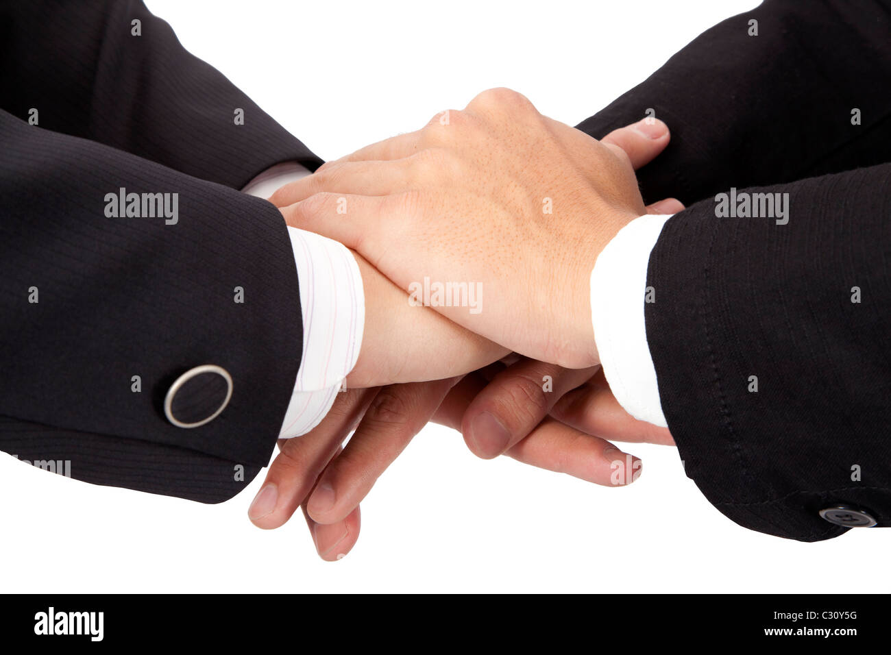 Trust and cooperation concept. stacked hands of businessman - Stock Image