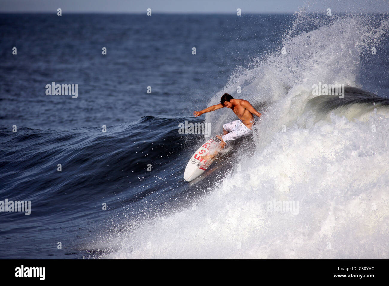 Traveling professional surfer Dane Reynolds enjoying glassy afternoon waves at the right point break, Las Flores, - Stock Image
