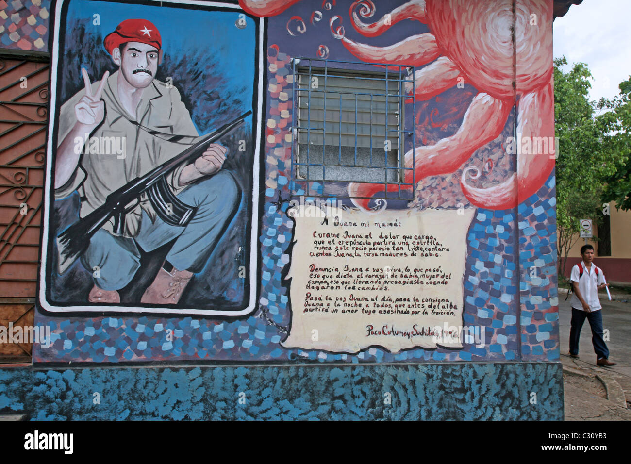 Mural of a local guerrilla who was killed during the civil war. Suchitoto, Cuscatlan, El Salvador, Central America - Stock Image