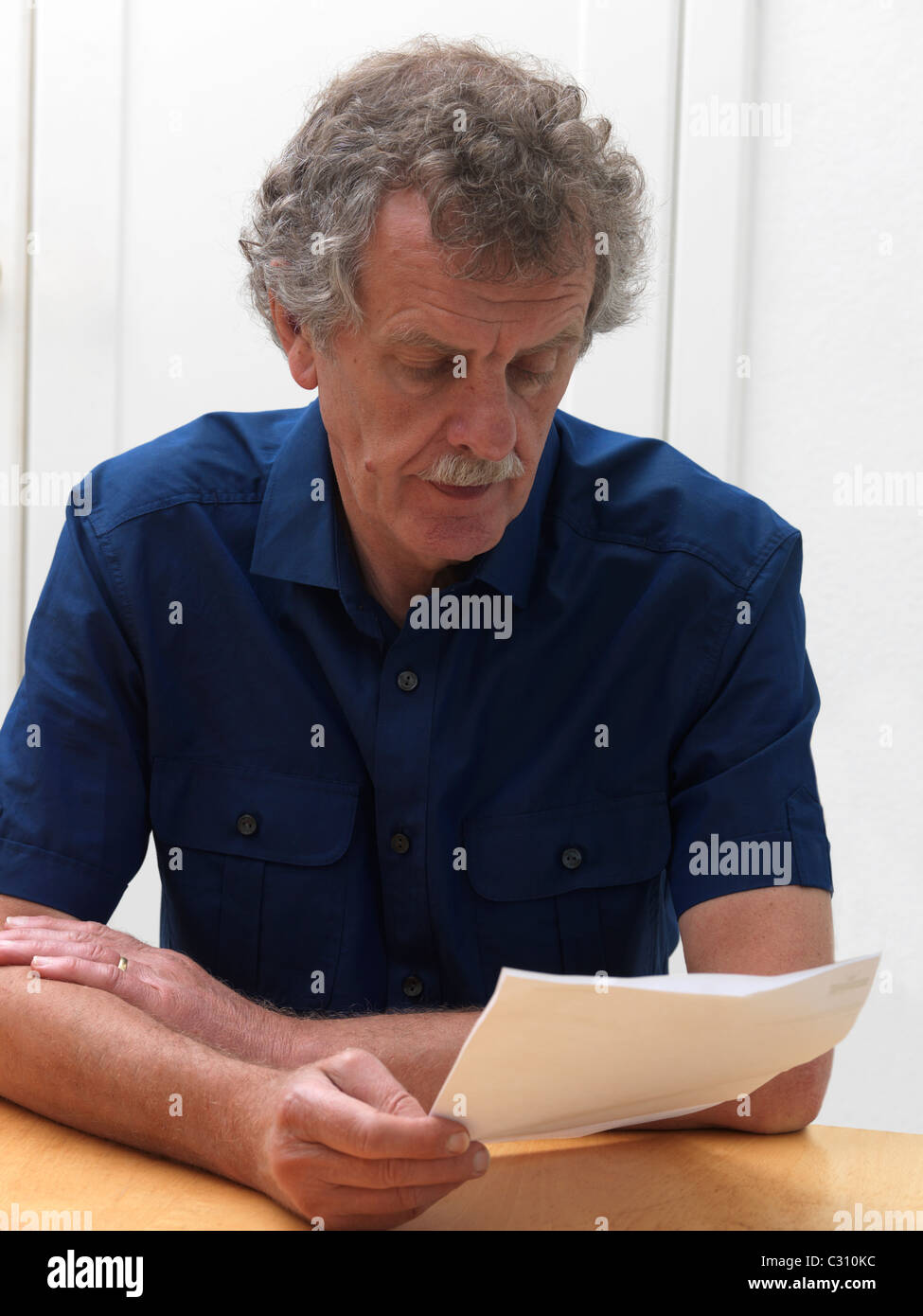 Man Reading A Formal Letter - Stock Image