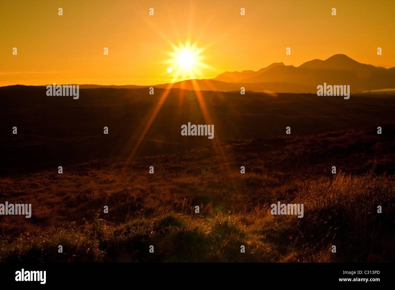 Sun setting on Isle of Sky, Scotland - Stock Image