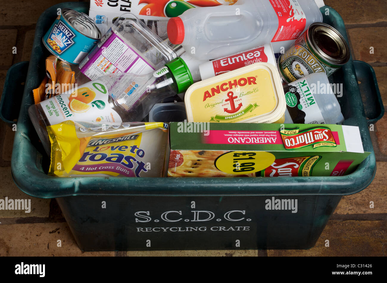 Household waste in recycling crate - Stock Image