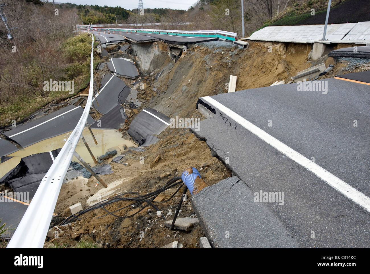 The road lies in pieces near the Fukushima No. 2 nuclear power plant in Tomioka Town Fukushima Prefecture, Japan - Stock Image