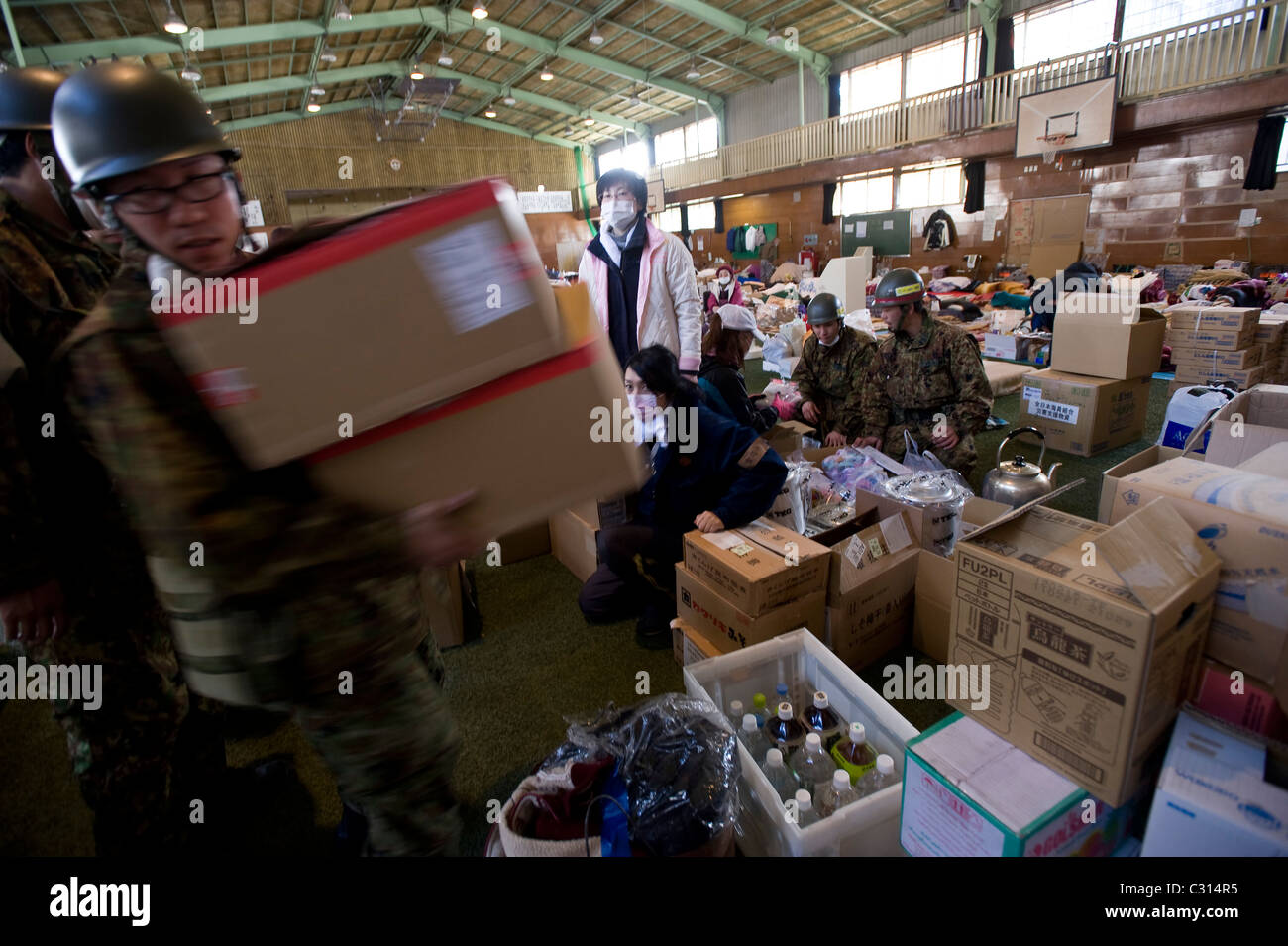 Members of Japan's Self-Defense forces deliver emergency supplies to a shelter in Kamaishi, Iwate Prefecture, - Stock Image