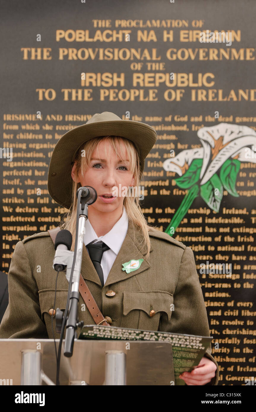 Belfast, Northern Ireland. 24 Apr 2011 - Woman dressed in a Republican Army uniform from 1920 reads the Irish Proclamation - Stock Image