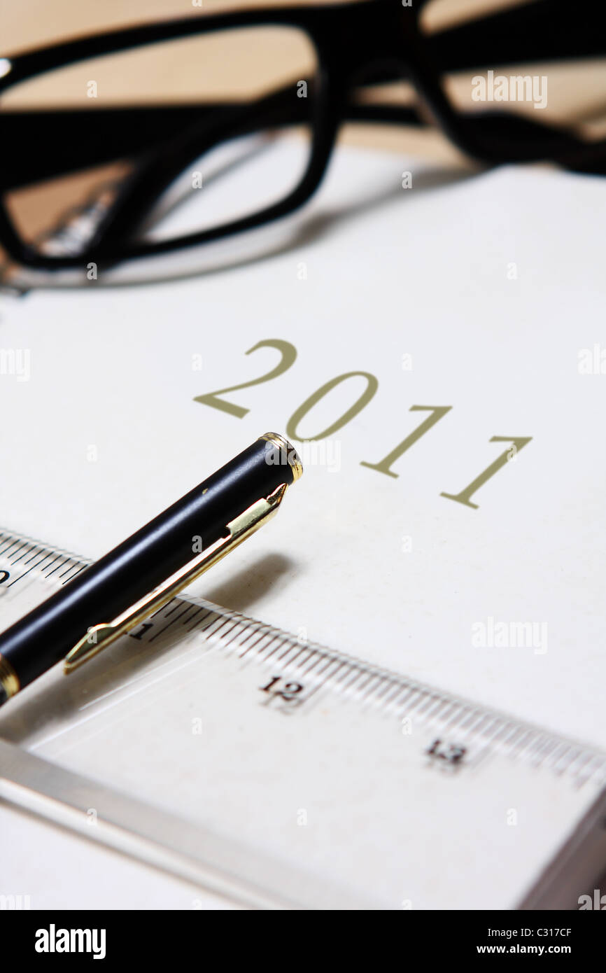 Leather diary 2011 with pen and ruler. - Stock Image