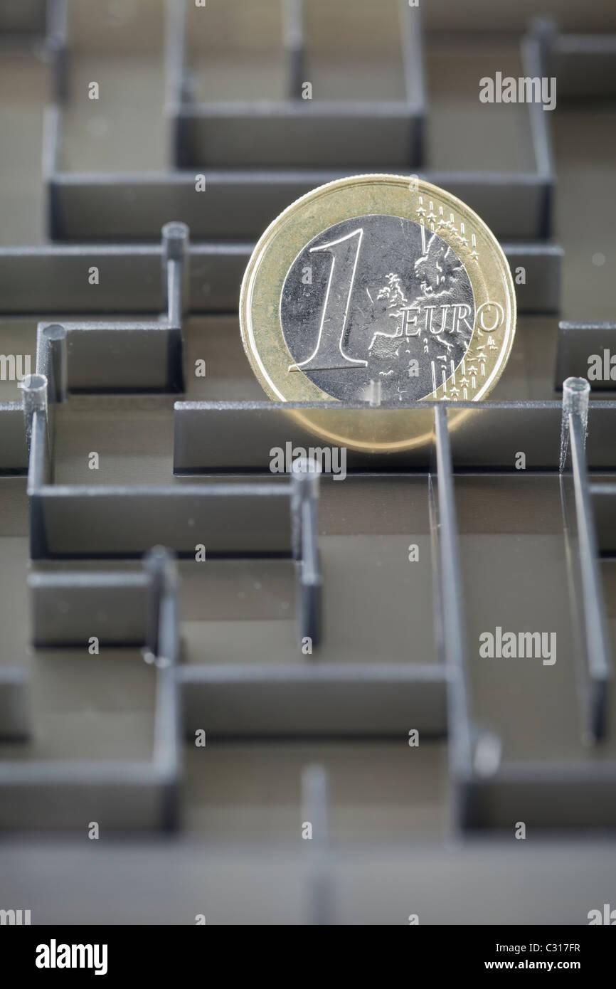 Euro coin in a maze - Stock Image