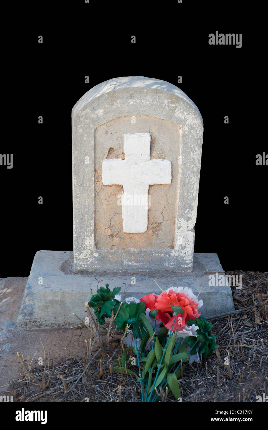 An old tombstone in the San Ysidro church graveyard, Hondo Valley, New Mexico. - Stock Image