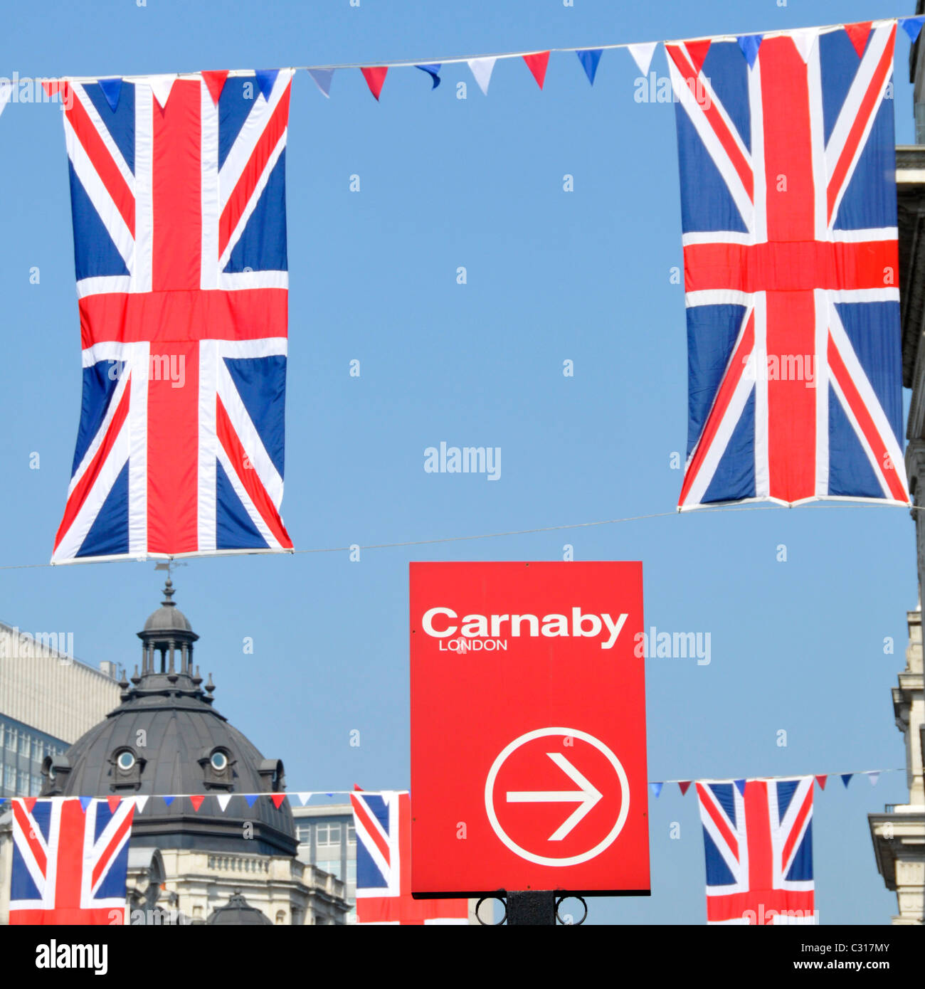 Carnaby Street London signs and Union Jack flags - Stock Image