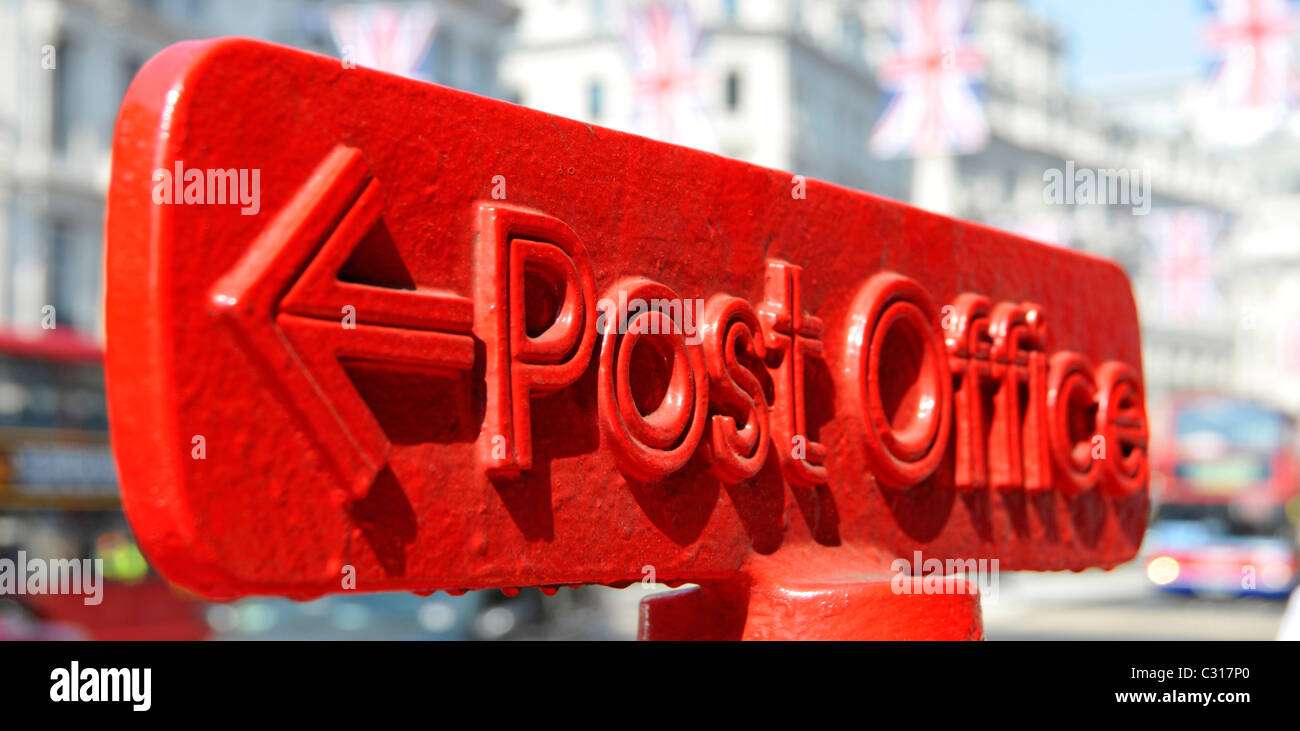 Red Post Office arrowed direction sign on top of post box Regent Street West End London England UK Stock Photo