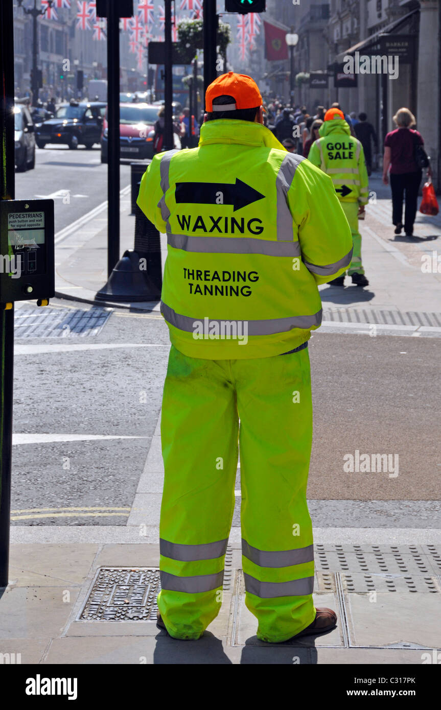 Men wearing high visibility clothes in Regent Street in answer to ban on Sandwich boards see my Alamy pic ref in - Stock Image