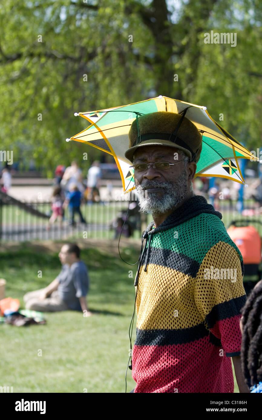 Black man with an umbrella hat in Streatham Park 3ce1447892b
