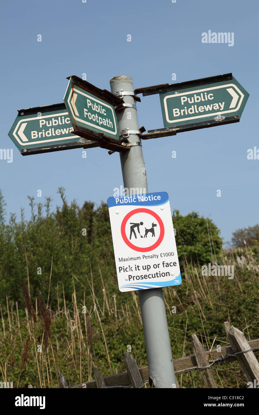A public footpath and public bridleway sign in the English countryside. - Stock Image