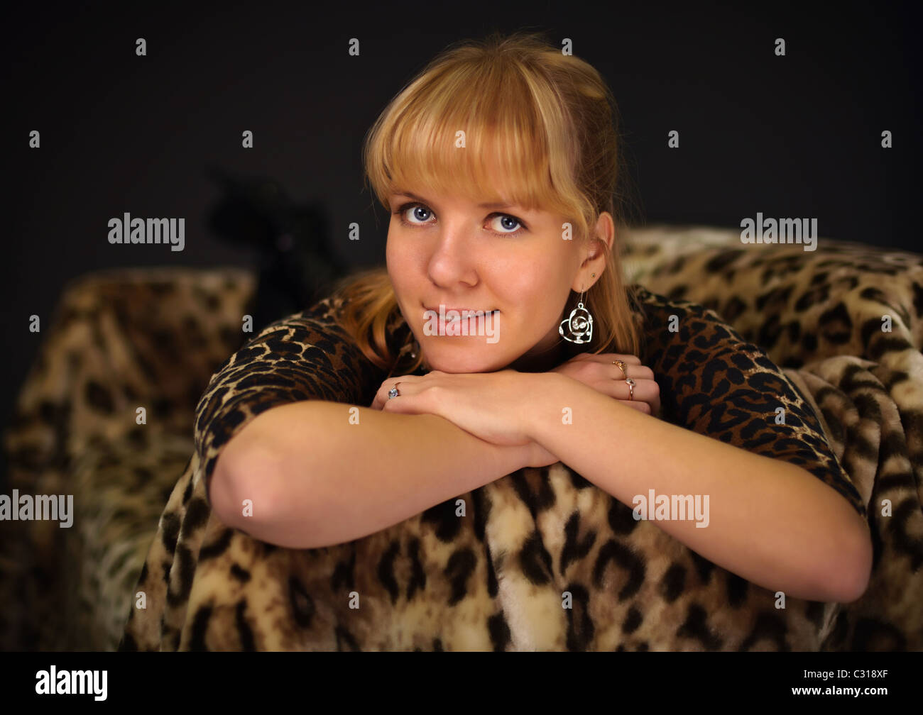0ce69917cc Portrait of a beautiful young girl in a leopard dress - Stock Image