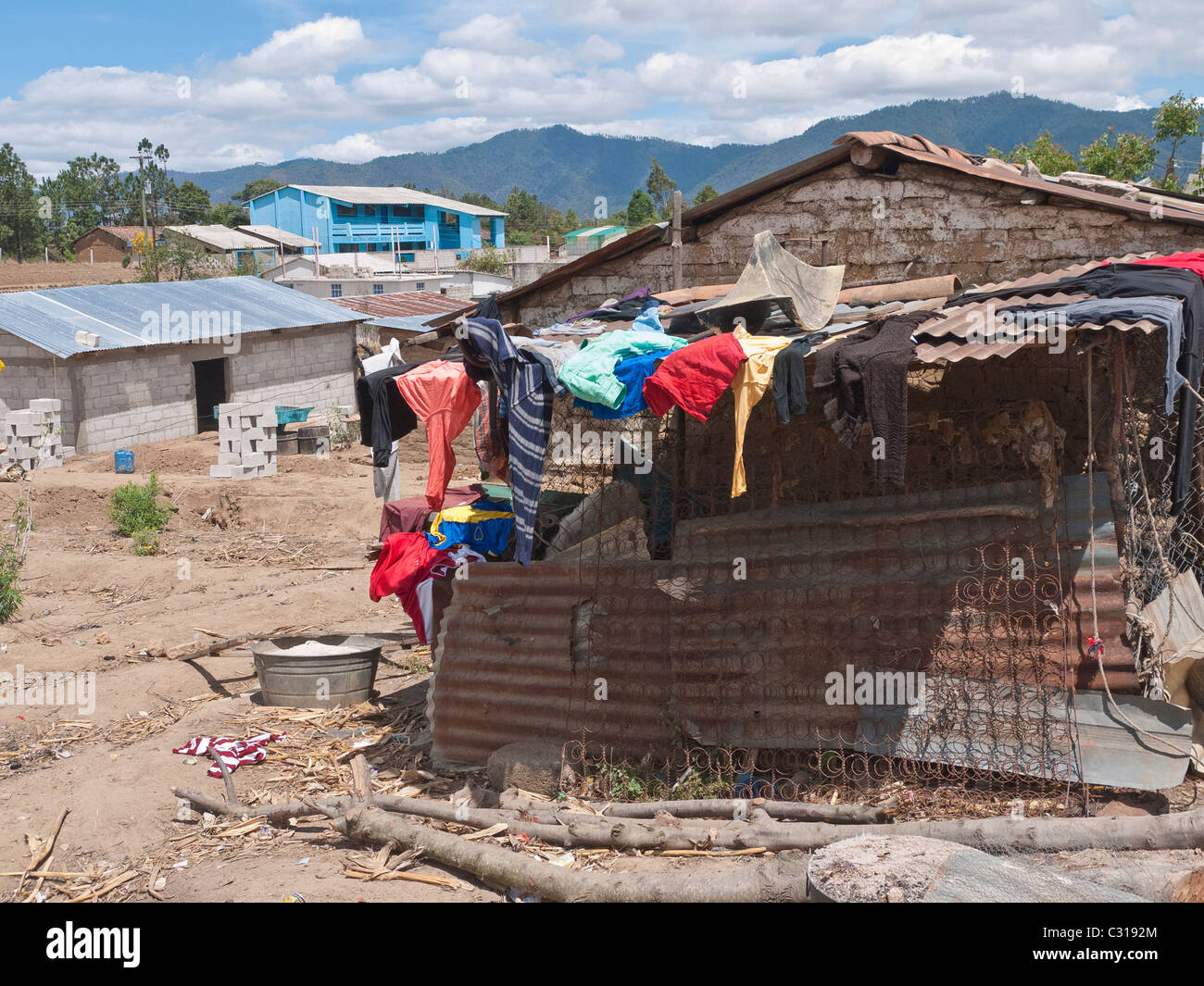 A family's wash hangs to dry off of the roof of a portion of their simple home in Totonicapan, Guatemala. Stock Photo