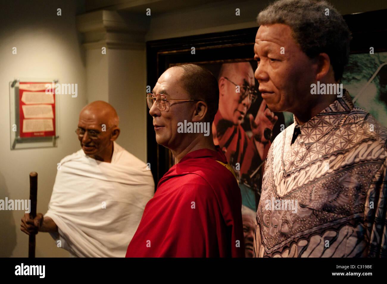 Mahatma Gandhi, Dalai Lama and Nelson Mandela in wax at the Madame Tussauds Wax Museum Amsterdam - Stock Image