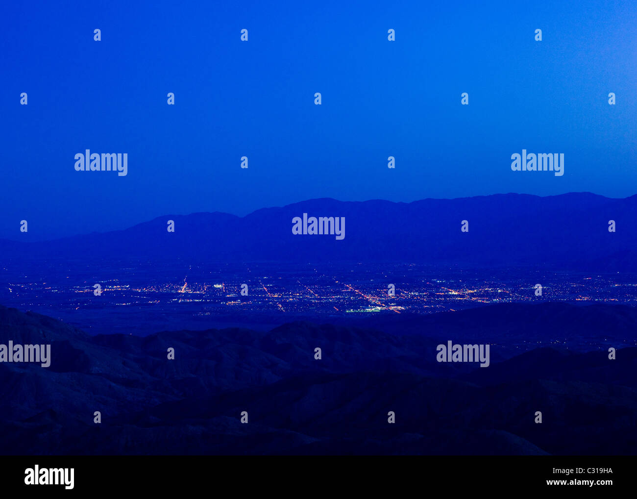 Evening city lights from a lookout - Stock Image