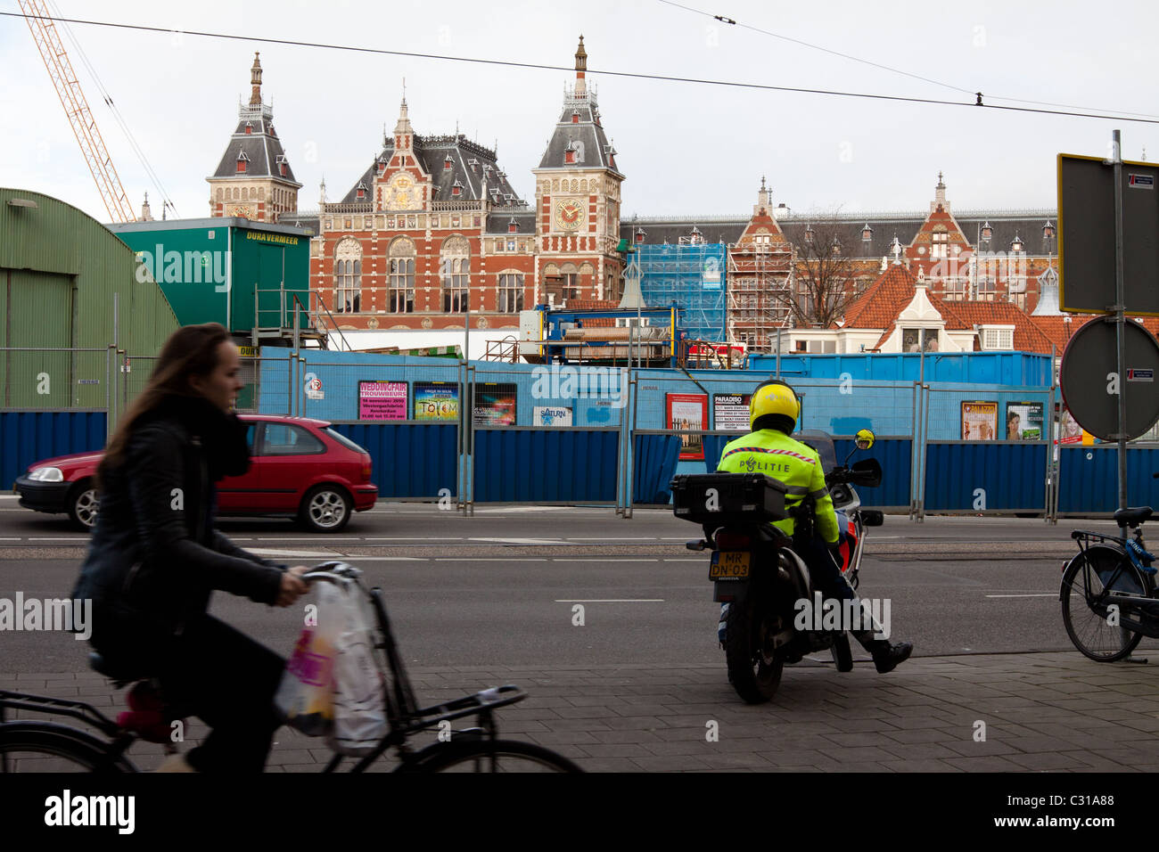 An Amsterdam Policeman in front of Amsterdam Central Station - Stock Image