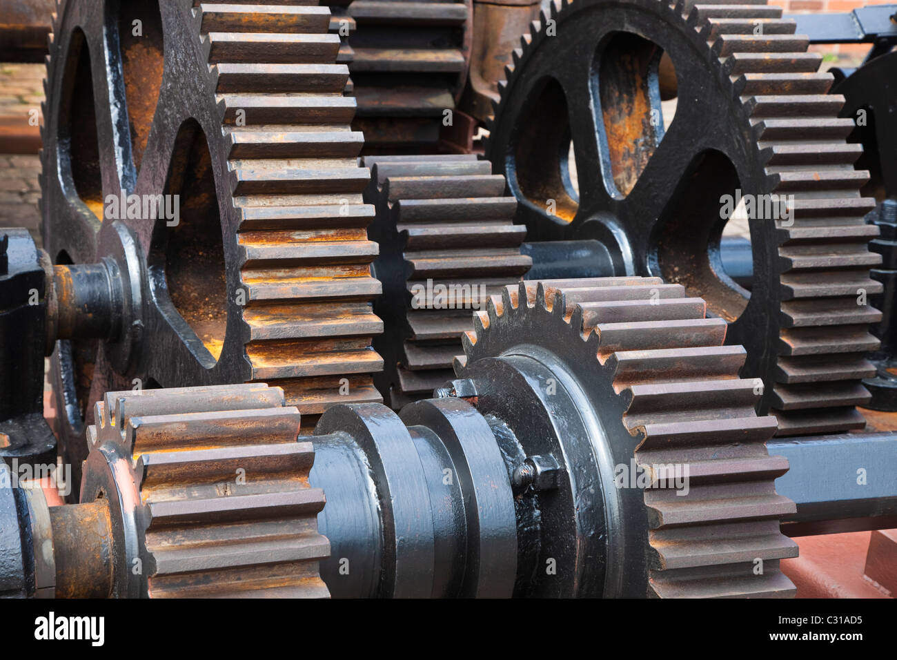 Gearing wheels and cogs on heavy engineering machinery, - Stock Image