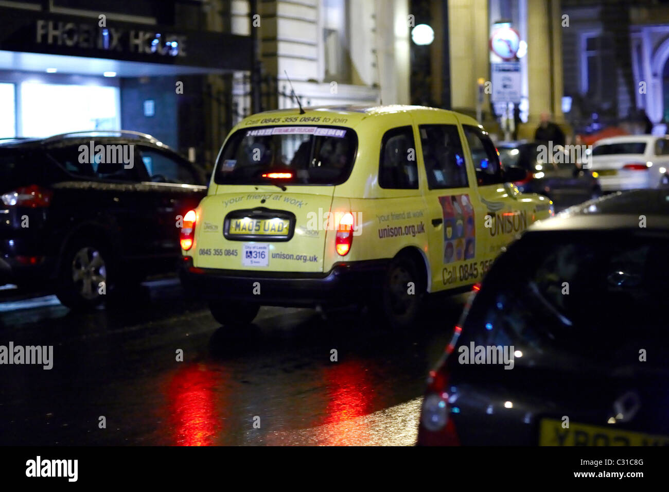 Taxi in Leeds at night - Stock Image