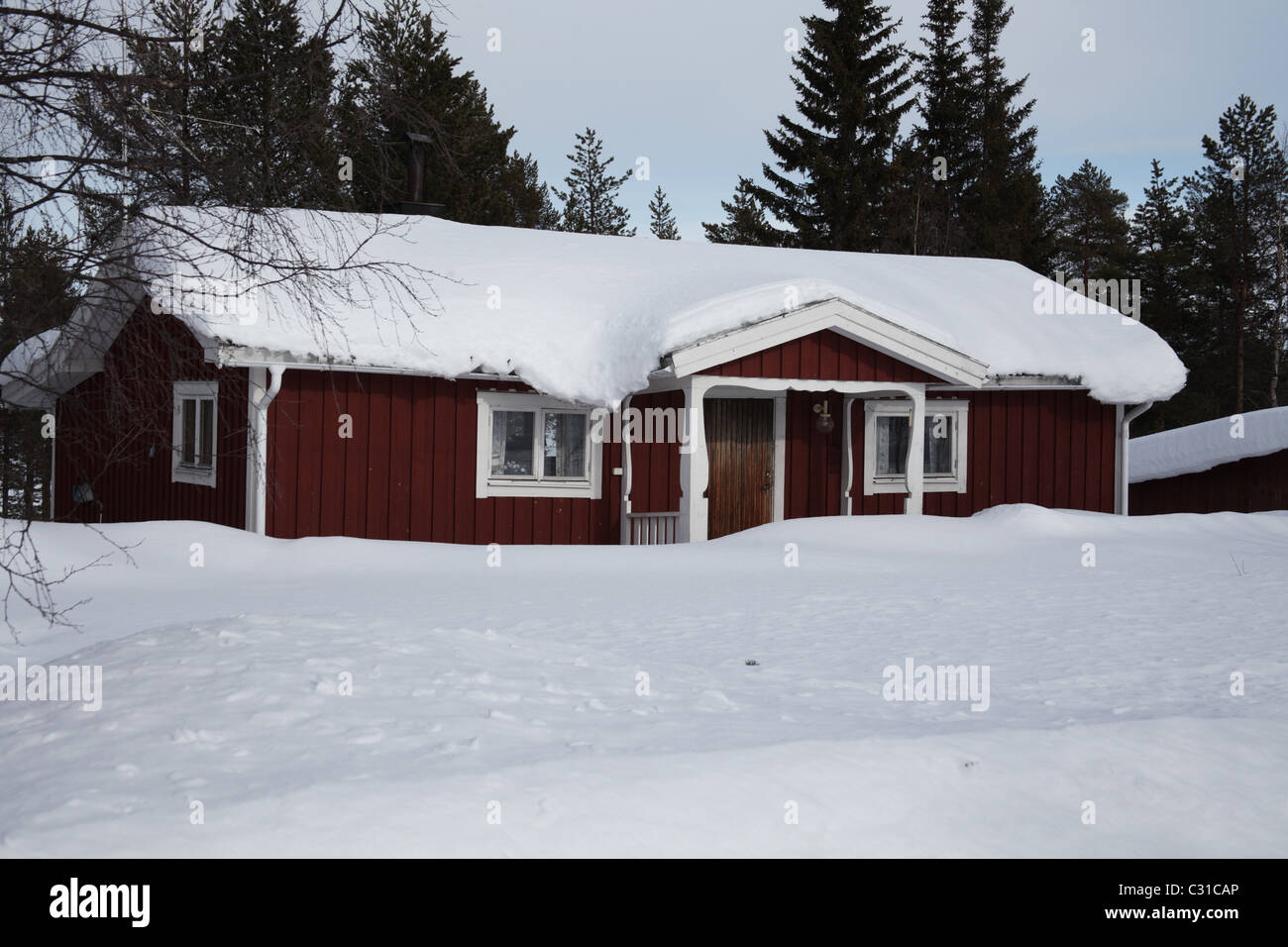Traditional wooden holiday home in Northern Sweden - Stock Image