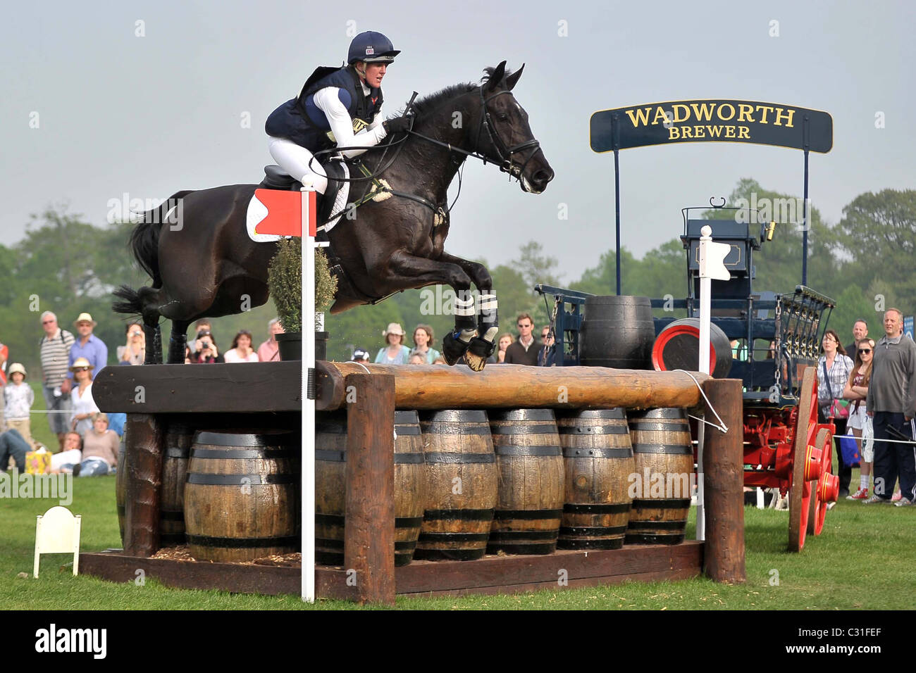 Nicola Wilson riding OPPOSITION BUZZ at fence 21. Mitsubishi Badminton Horse Trials - Stock Image