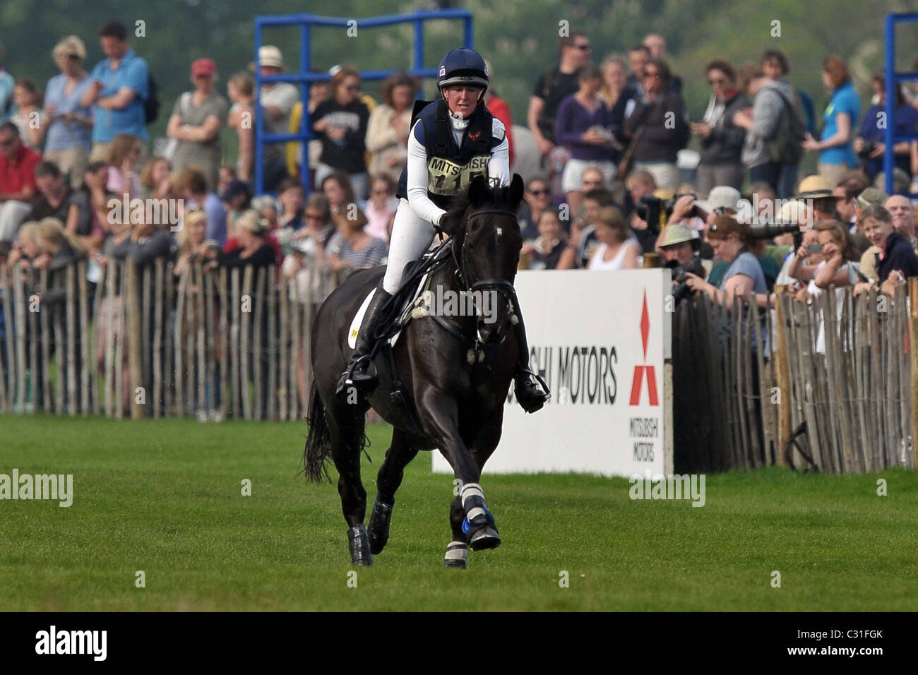 Nicola Wilson riding OPPOSITION BUZZ gallops towards fence 21 watched by the spectators. Mitsubishi Badminton Horse - Stock Image