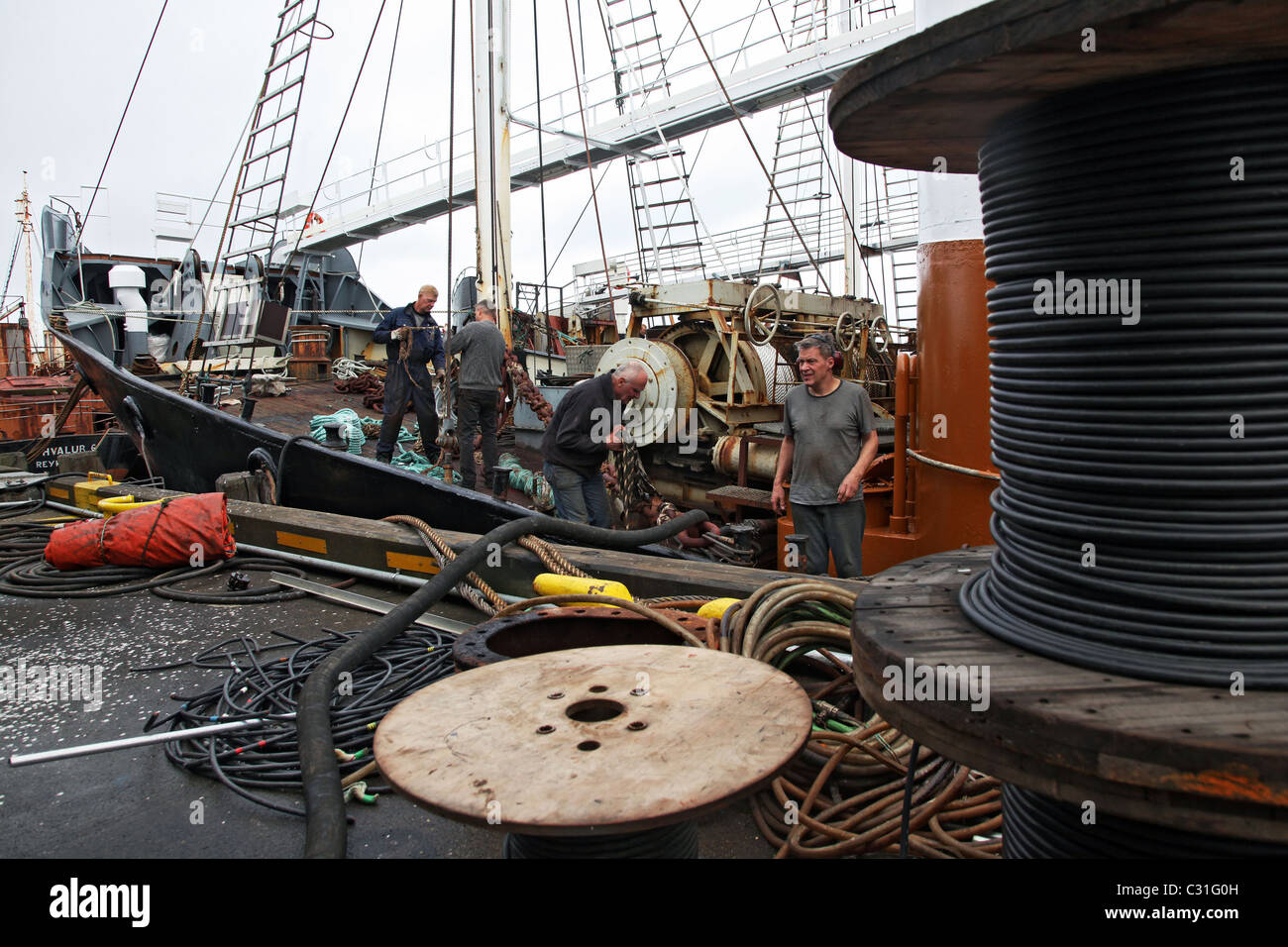 WHALE FISHING, THE CREW OF ONE OF KRISTJAN LOFTSSON'S WHALERS READY TO CAST OFF FROM THE PORT OF REYKJAVIK, ICELAND, Stock Photo