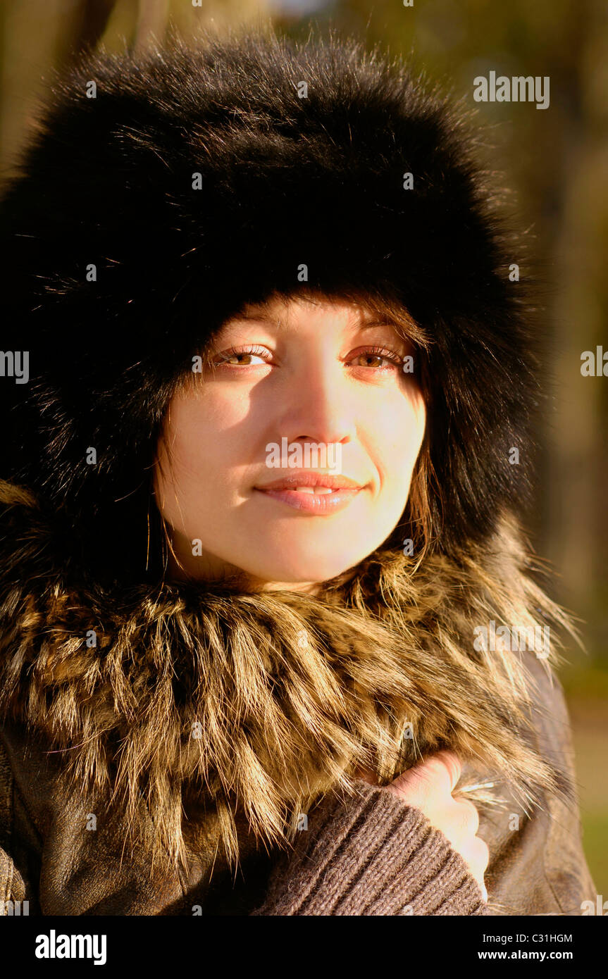 a7298b2cf1c PORTRAIT OF A YOUNG WOMAN WEARING A RUSSIAN FUR HAT AND A FUR COLLAR - Stock