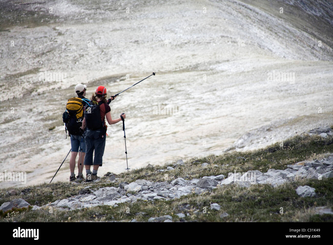 Two hikers survey their route in the southern Chilcotin mountains. Stock Photo