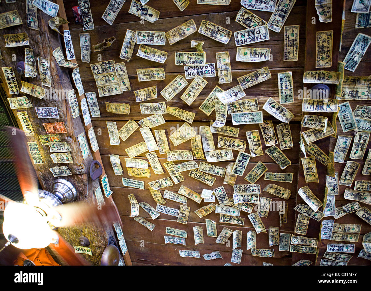 Signed one dollar bills tacked on the ceiling and walls of western bar - Nevada USA - Stock Image