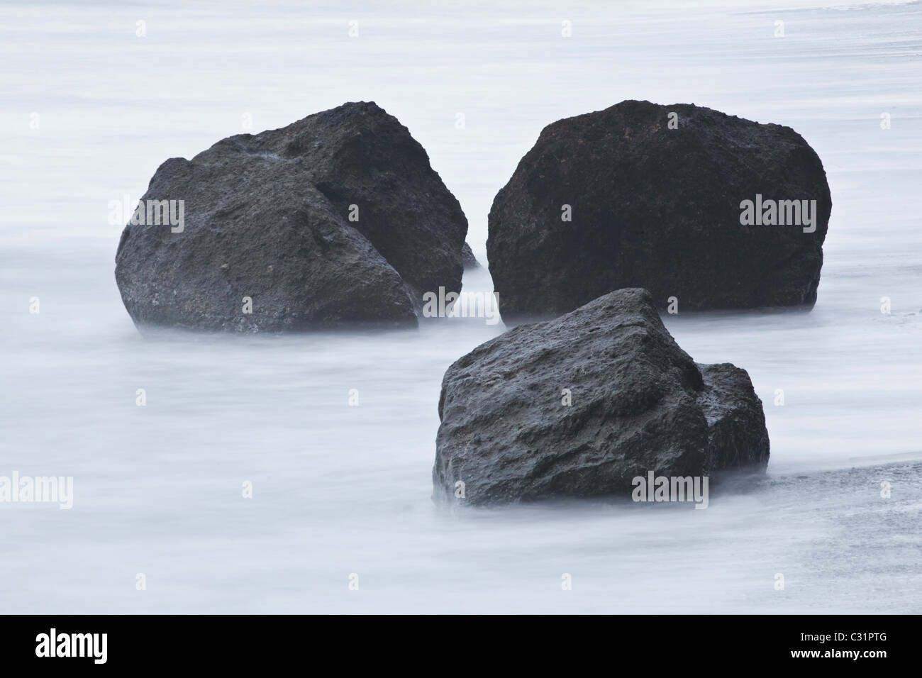 Three large boulders on Ruby Beach, Olympic National Park, Washington. - Stock Image