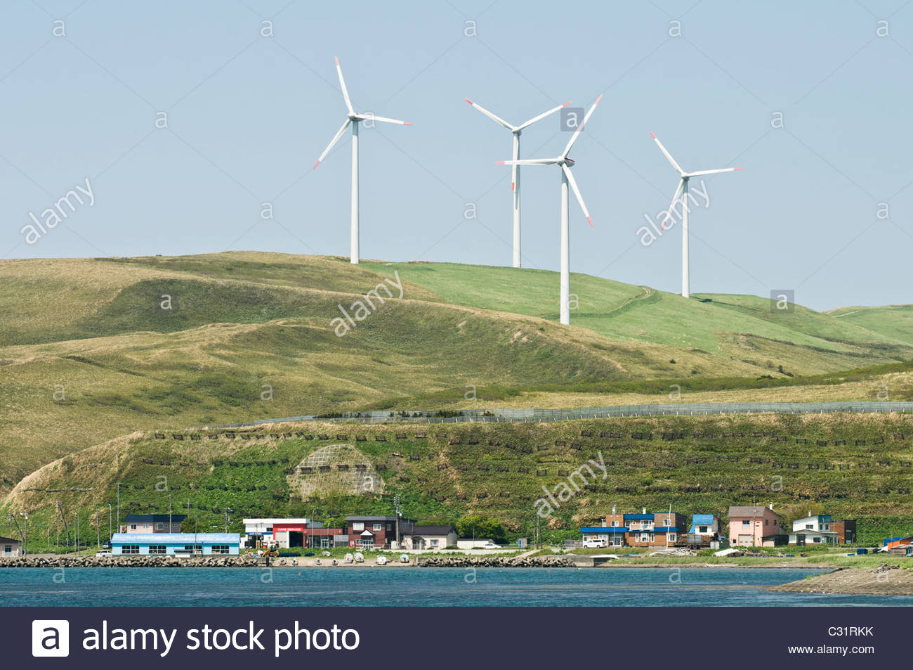Wind turbines over Soya town, Hokkaido, Japan - Stock Image