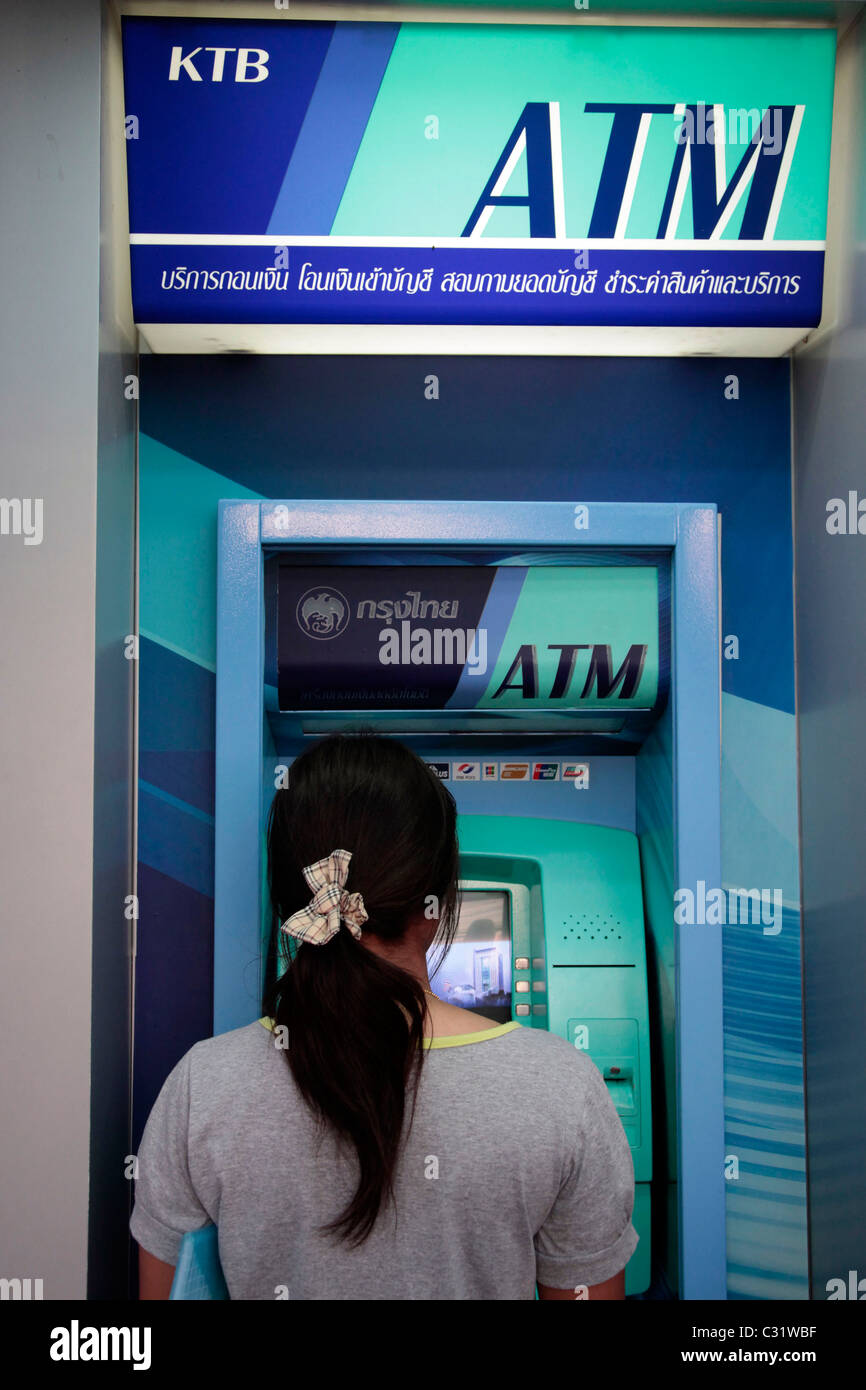 WOMAN IN FRONT OF A AUTOMATIC TELLING MACHINE ATM, BANG SAPHAN, THAILAND, ASIA - Stock Image
