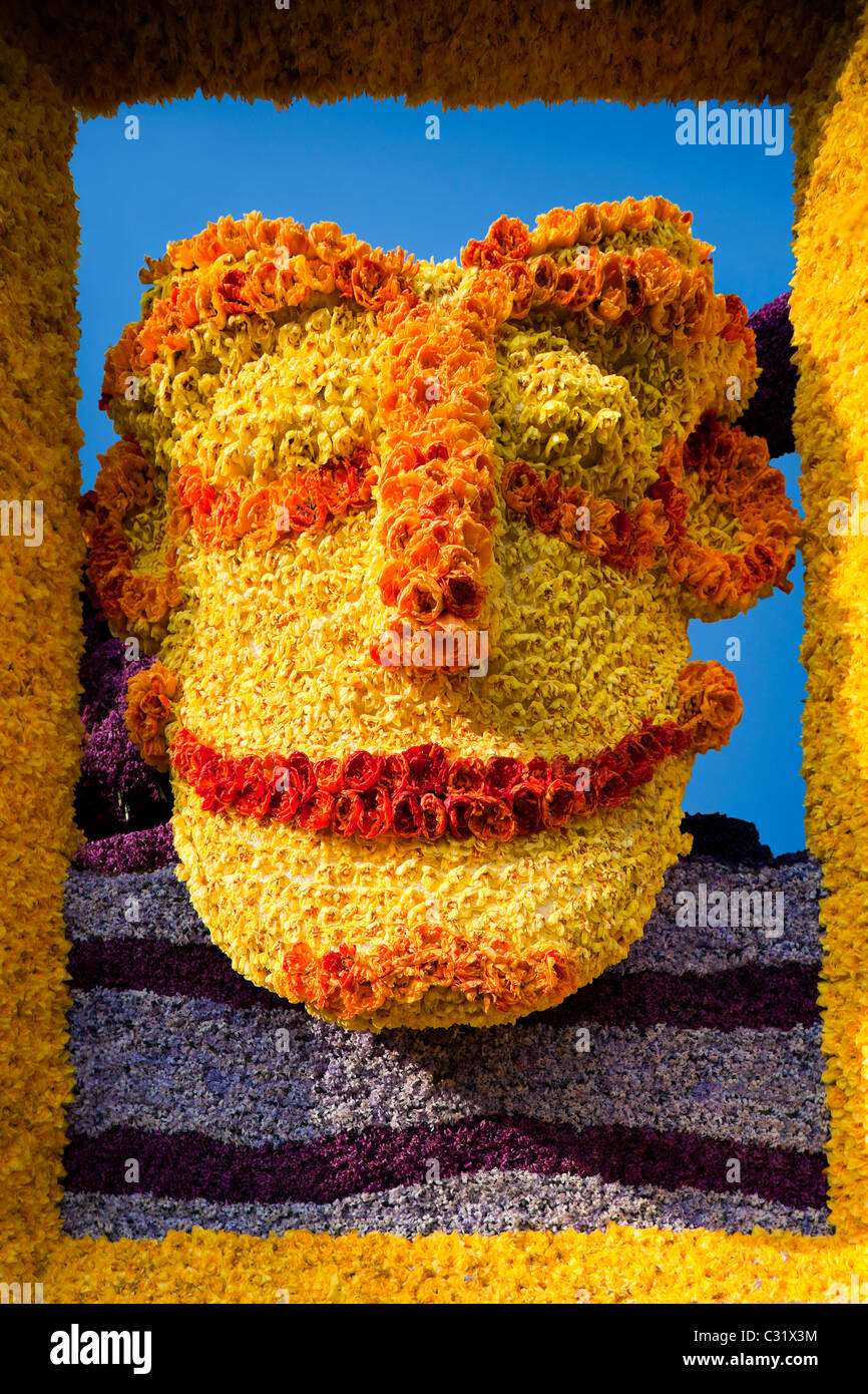Float in the annual flower parade in Haarlem Holland Netherlands. Colorful mask made of flowers tulips hyacinths - Stock Image