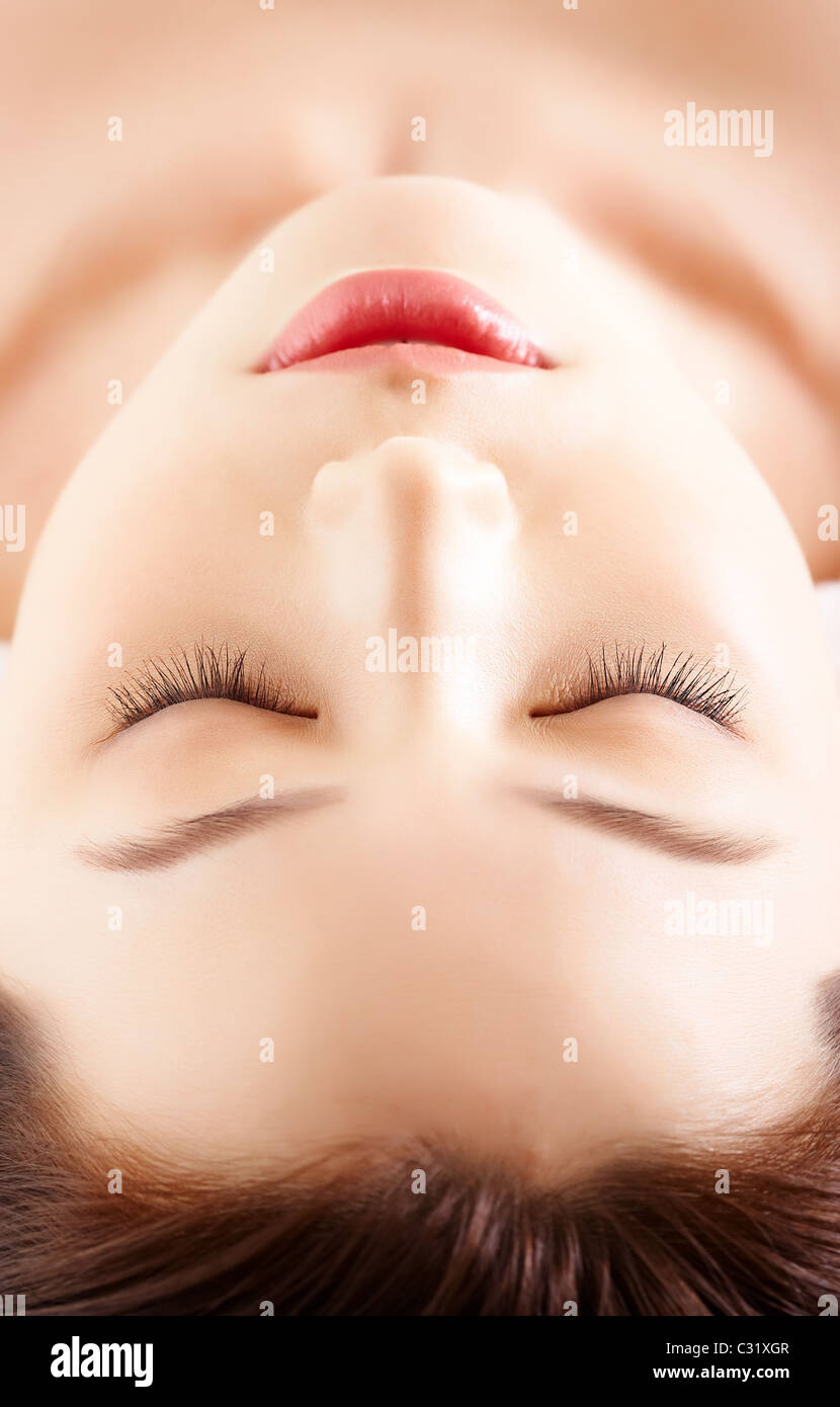 Face of calm female before procedure of facial massage - Stock Image