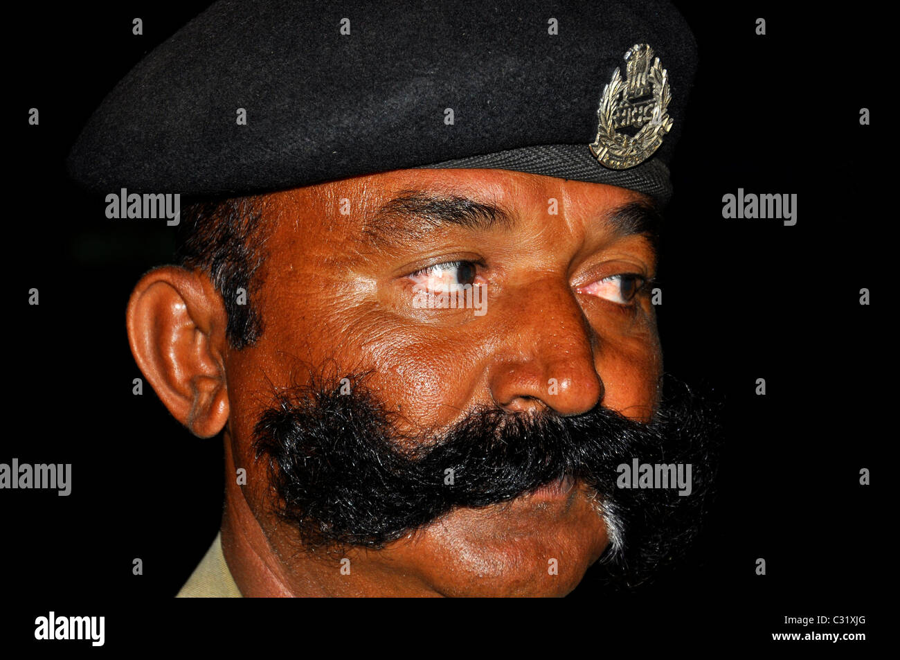 Moustache of an indian cop - Stock Image