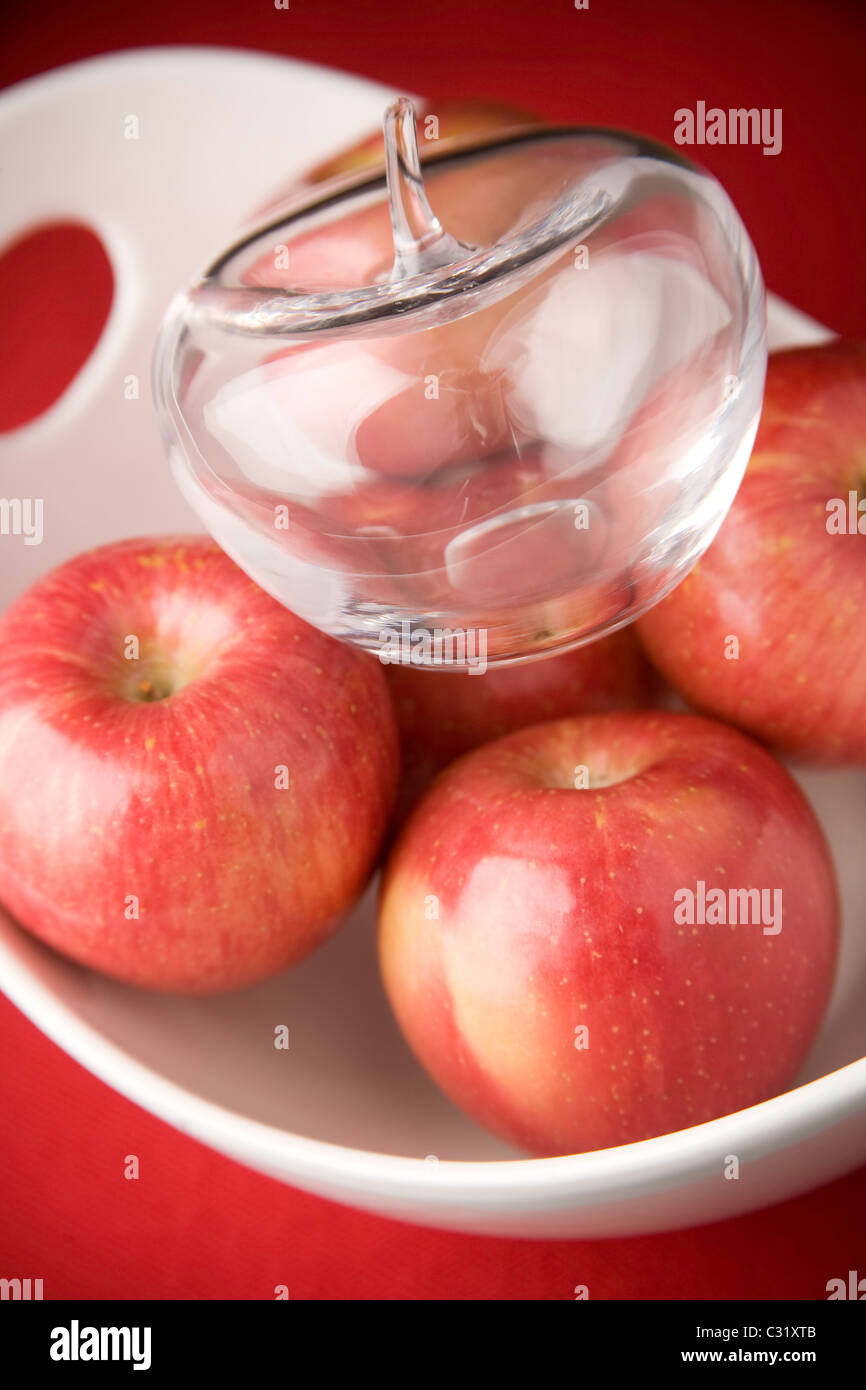 A bowl of apples with one glass apple - Stock Image