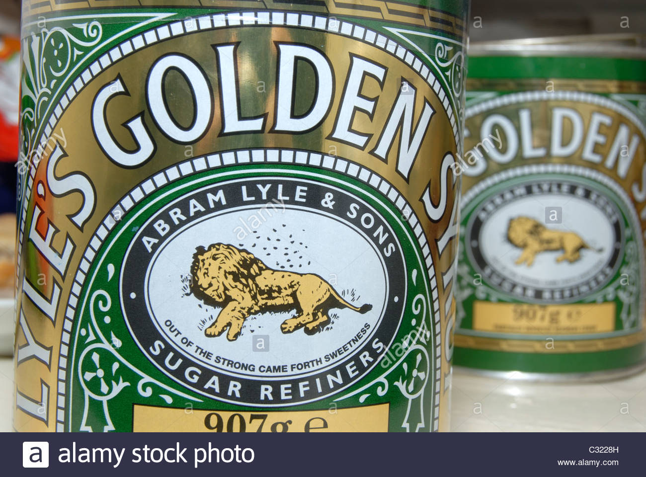 Tins of Lyle's Golden Syrup. - Stock Image