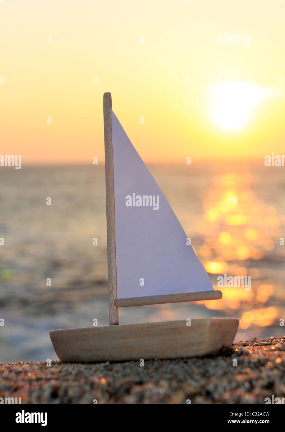 Model boat on beach - Stock Image