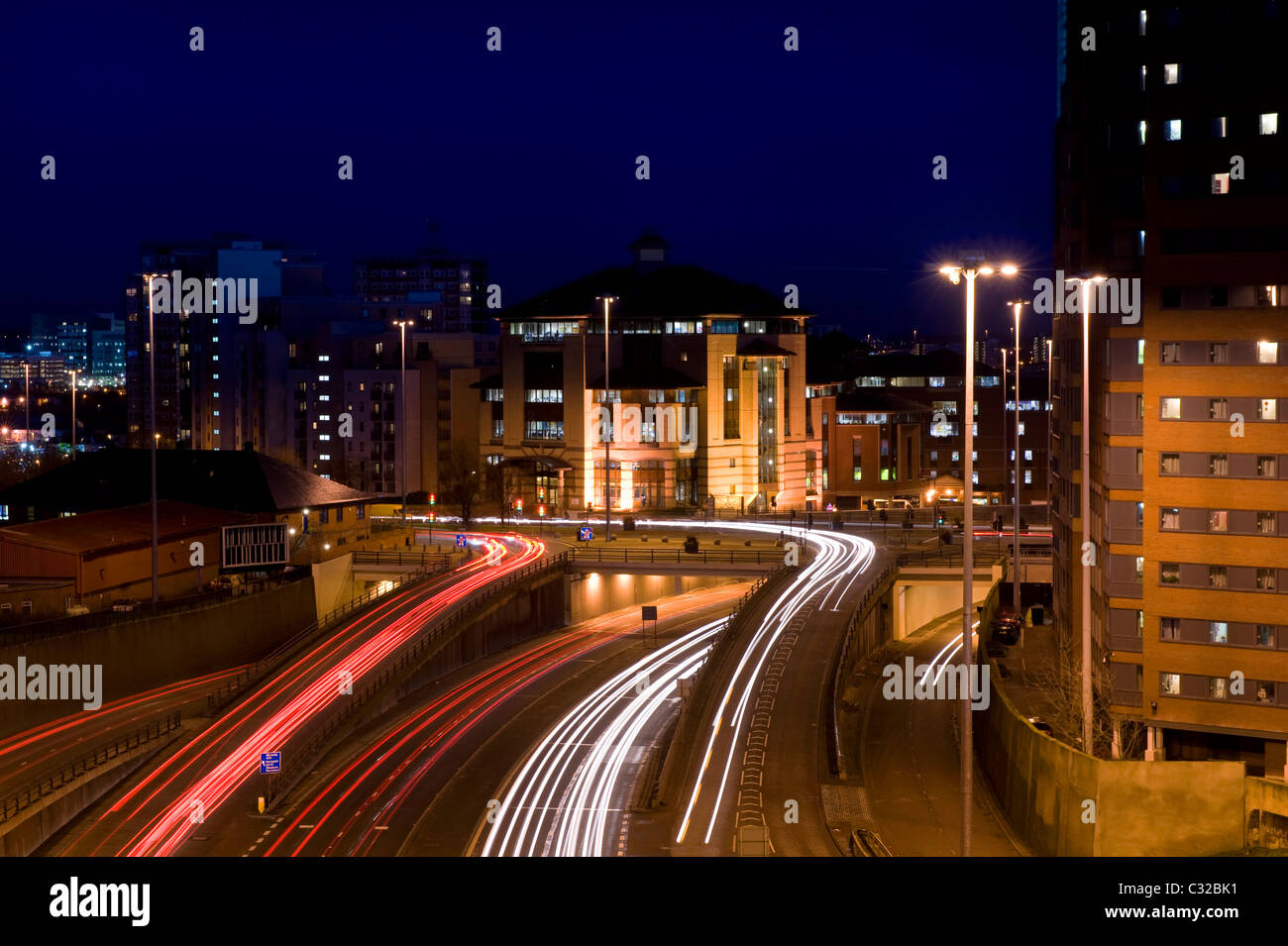 traffic light trails of vehicles traveling too and from the city of leeds at night yorkshire uk - Stock Image