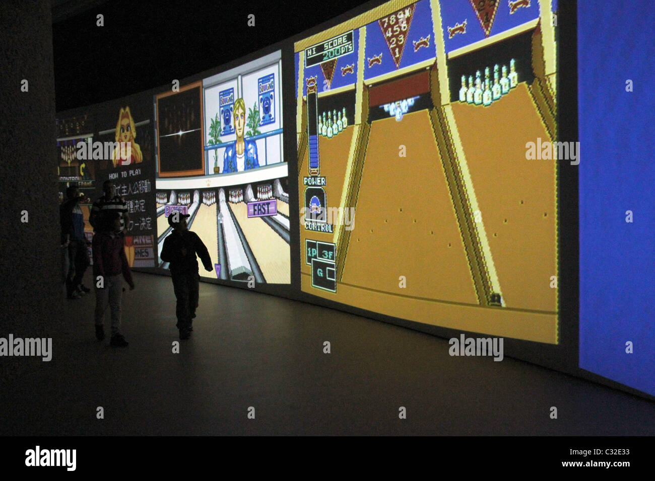 Cory Arcangel installation at the Barbican in London is an installation with 14 bowling video games from the1970s - Stock Image