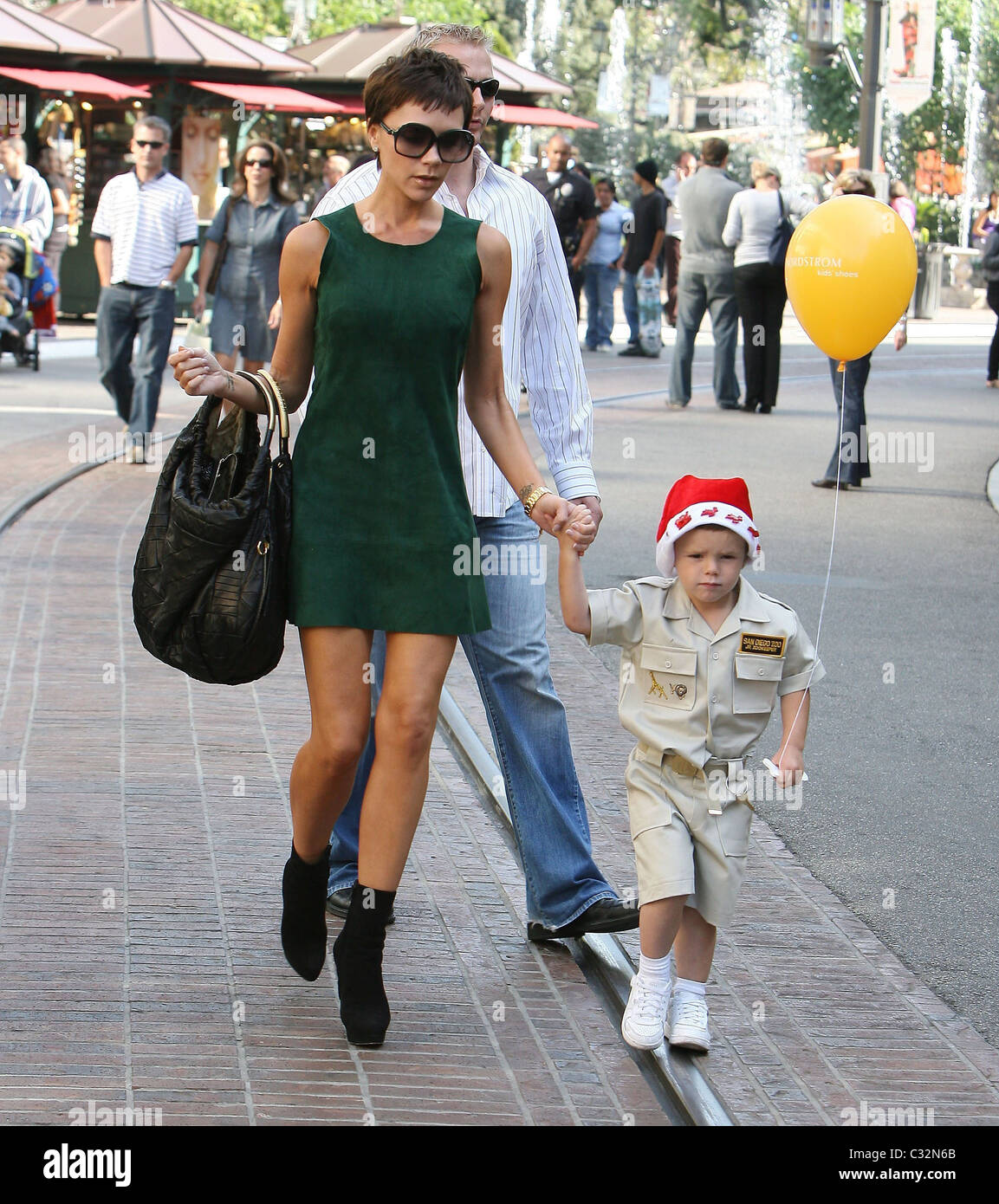 Victoria Beckham Wearing A Little Green Dress And Son Cruz Beckham