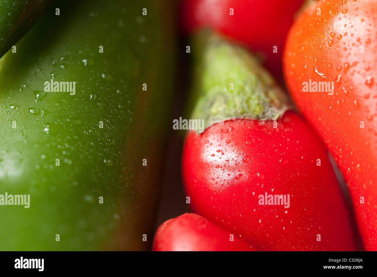 Green and red chilli peppers, full frame - Stock Image