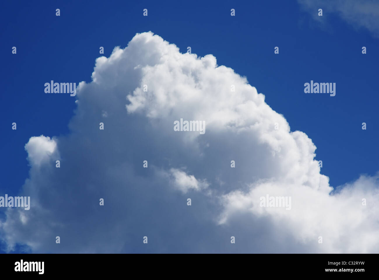 Wonderful clouds against blue sky - Stock Image