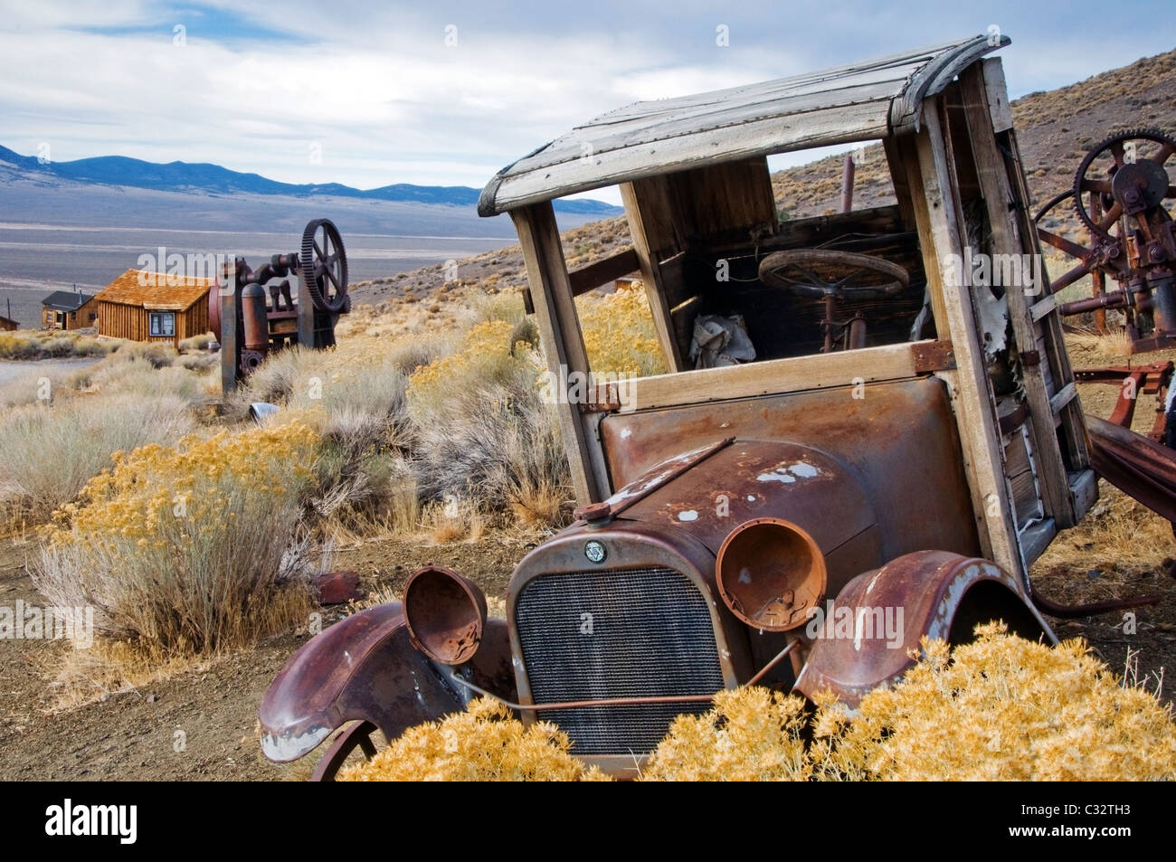 An old abandoned car sits permanently idle in the ghost town of Berlin, NV. - Stock Image