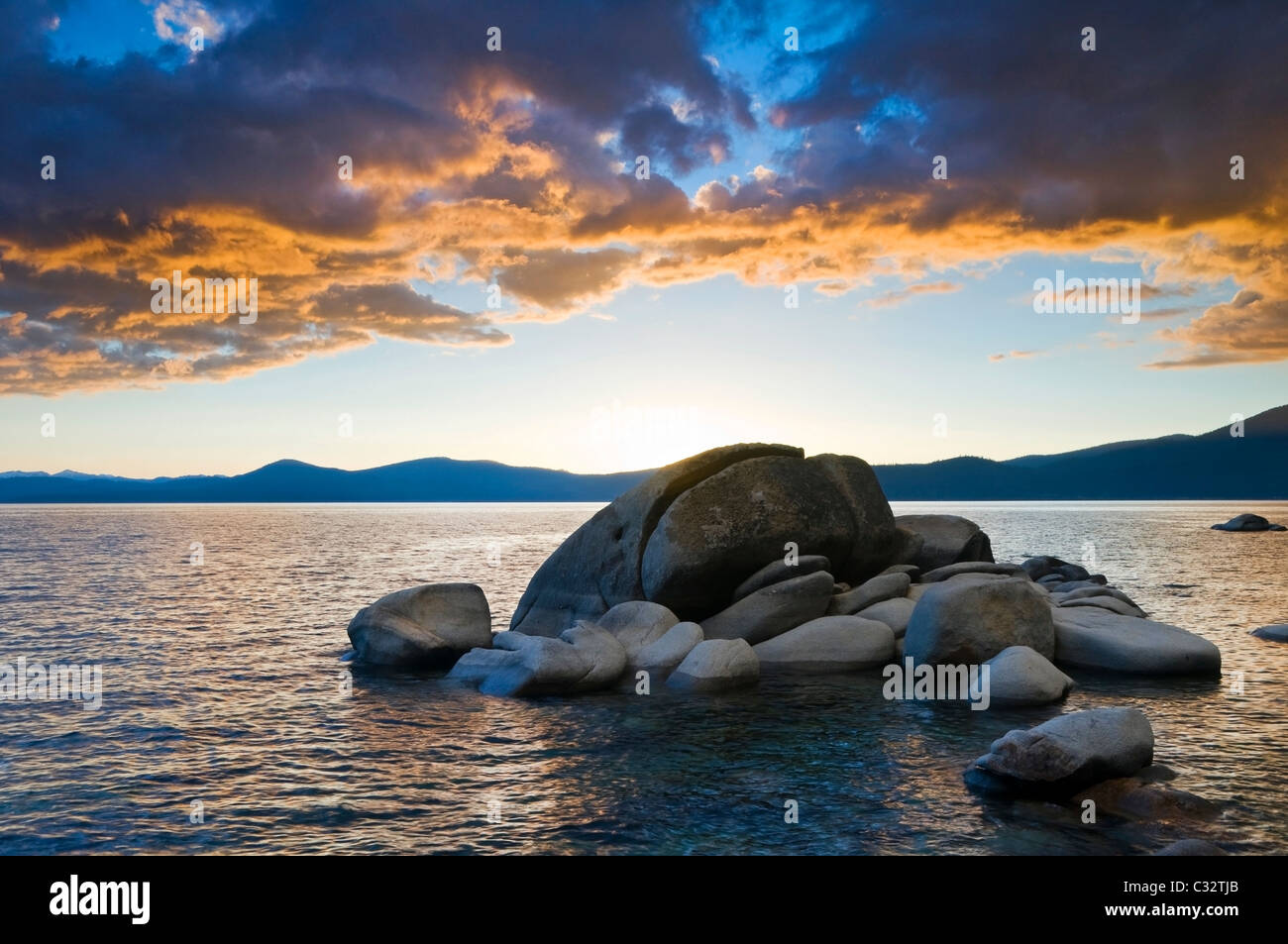 A sunset at Whale Rock on the east shore of Lake Tahoe in the summer, NV. - Stock Image